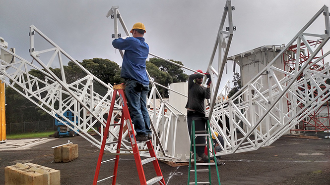 Installing the main rib diagonal supports of the antenna reflector dish.