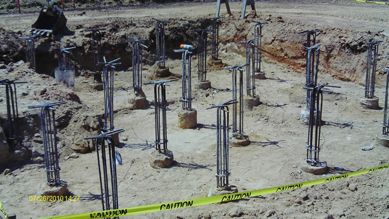 Ant foundation with auger cast pilings for Foundation pilings